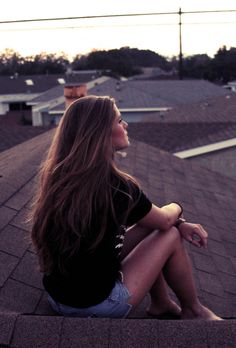 Sitting on the roof and thinking on a summer night. Watching the sun go down is just as pretty when you're alone with your thoughts.