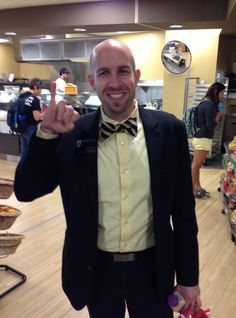Emporia State Center for Student Involvement (CSI) senior director Jason Bosch flashes the Stingers Up sign at the Memorial Union.