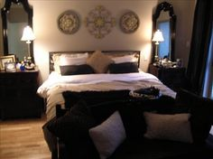 Love the idea of the mirrors on the bedside tables... great bedroom!