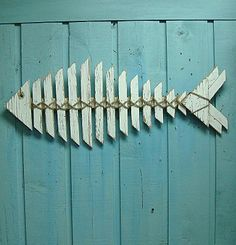 I think this is my favorite so fat.  Fish Skeleton Sign Weathered White Wall Art Beach by CastawaysHall,