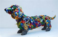 Contemporary artist Robert Bradford creates life-size animal sculptures from discarded items like colorful toys, clothes pins, buttons and other plastic pieces.
