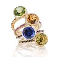 "It's Friday! ... ""and all that jazz"". Tanzanite, peridot, lemon quartz & citrine Jazz Rings with sapphire & diamond bands. Note: not particularly conservative, but very festive. #tanzanite #citrine #lemonquartz #peridot #jazz #biiju  #tgif #fridayfeeling"