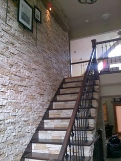 Airstone on a staircase.I was thinking of this exact look for the cement stairs coming in from the garage - Airstone risers with wood tread. Love to see that it looks as good in real life as it did in my head :-)