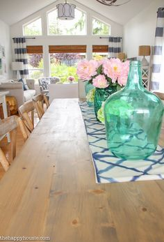 Lake House Summer Tour with beachy coastal colourful entry hall dining room and deck at the happy housie-12