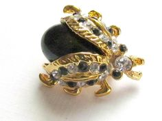 Gold Bug Pin Black and White Rhinestones Monet by vintagepaige on Etsy https://www.etsy.com/listing/266809093/gold-bug-pin-black-and-white-rhinestones