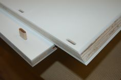 Corian & Birch Ply laminated components being jointed for a bathroom sink cabinet