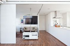 Fidalga 727 by Sub Estudio (9) - feat sliding doors for a hidden extra room and rotating tv pole stand