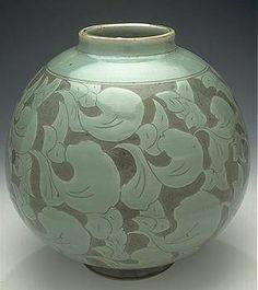 celadon vase with carved floral design by jan cannon.