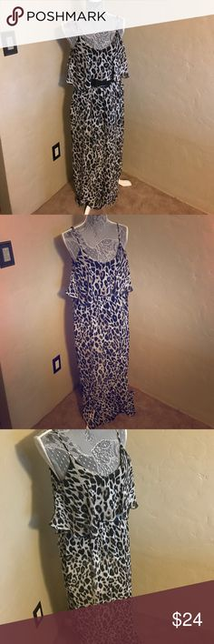 Maxi dress Black and tan leopard print maxi dress with flowy overlay . Looks great with a black belt. Has adjustable straps and small slits on each side of the legs. *belt not included* size xs but fits big. Very flowy and stretchy material will fit to small or medium . Dresses Maxi