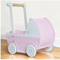 Pink Wooden Doll's Pram – I would love this for Evie xx
