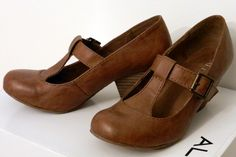 Brown t-strap shoes by Aldo