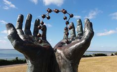 """Brian Whitehead took this photograph this morning whilst going for a stroll along the Westcliff promenade at Ramsgate Kent. It shows bronze sculpture Hands and Molecule by David Barnes with Pegwell Bay in the background """"both basking in the summer morning sunshine"""". To mark the start of the Olympic Games in #Rio2016 this week's theme for #EnglandsBigPicture will be the Olympic story. Send your Olympic-inspired pictures to england@bbc.co.uk #england #kent #ramsgate #sculpture…"""