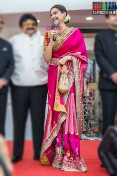Actress Sonam Kapoor inaugurated a new showroom of Kalyan Jewellers in Chennai on Sunday. The actress, known for her fashion sense, opted for an ethnic look for the event. She wore bright pink saree by Abu Jani and Sandeep Khosla, and chunky gold jeweller Indian Wedding Outfits, Bridal Outfits, Indian Outfits, Trendy Sarees, Stylish Sarees, Simple Sarees, Dress Indian Style, Indian Dresses, Wedding Saree Collection