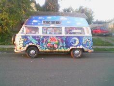 Beautifully decorated hippie bus.