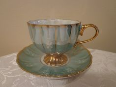 Aqua Blue Irridescent Opalescent Mother of Pearl Teacup and Saucer Set