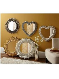 http://www.very.co.uk/gallery-heart-shaped-mirror-with-rose-detail/1269625996.prd