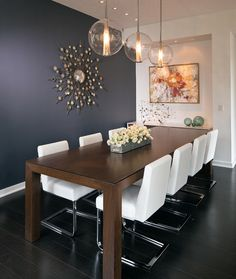 contemporary dining space : chairs : light fixtures : art  : wall color