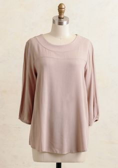 A must-have addition to your closet this fall, this taupe-hued blouse features a rounded neckline and a versatile relaxed fit. Finished with three-quarter sleeves and a darling three button closu...