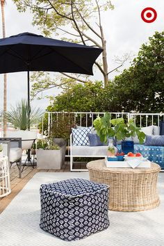 Patio style tip from Target Home Expert, Emily Henderson: Begin with a foundation piece(s) of furniture like a sofa and/or chairs. Umbrellas are essential to keeping the space cool on hot summer days. Next, pick a couple of hues that you love. Mix and match outdoor pillows, decor and accessories in a variety of patterns within your chosen color palette to style the look. Add an assortment of potted plants for an ever more lush outdoor oasis.