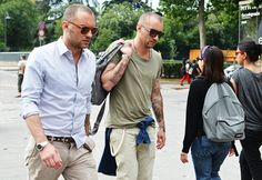 Khakis are generally dorky. Combined with a shaved head, proper fitting-slightly untucked button up gives it an edge. Sleeves rolled up--he means buisness!