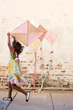 Fabric kites! Wonder what sorority this girly's meant to be in? :)  ANswer: Girls like to fly kites Sorority.