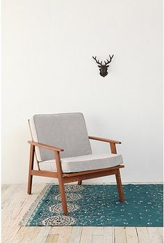 Danish modern chair and blue rug - happy to ditch the antlers though!