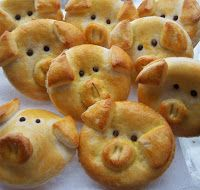 Piggy Bread... Kids would LOVE these; dipped in a pizza marinara sauce. Although the recipe sounds a bit complicated. Must be a way to make these with prepared refrigerated doughs.  The recipe mentions a 'first dough' followed by a 'puff dough' and mix them together ??? OK