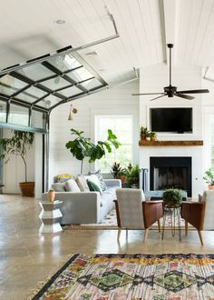 roll up doors in the living room of this Vintage Eclectic Barn   room of the week coco kelley