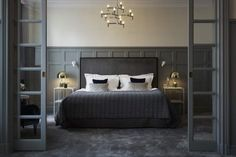 """Gray has gotten a bad rap for being the """"play it safe"""" color in home design. We'll show you how bold home design can be when the normally dull shade is used in an adventurous way. Photo: The Grand Hotel in Stockholm, Sweden Boutique Hotel Bedroom, Hotel Bedroom Design, Bedroom Decor, Hotel Bedrooms, Boutique Hotels, Bedroom Ideas, Master Bedroom Plans, Dream Bedroom, Master Suite"""