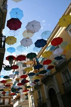 Umbrellas! I can totally see jean-claude & christo doing something like this!