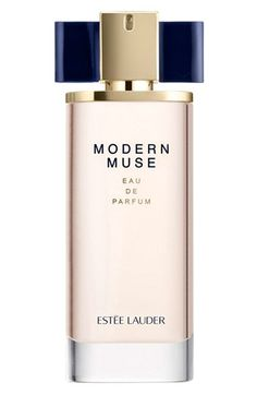 Estée Lauder's chic new fragrance for women, Modern Muse Eau de Parfum Spray, features a lush blend of rich florals and sleek woods with a contrast of exotic mandarin, jasmine sambac, amber wood and patchouli.