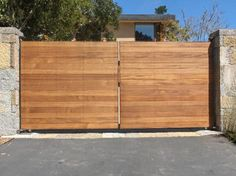 1754 Iron Wood Gates at www.ccoigateandfence.com Driveway Gate, Custom Design, Automatic Gate, Electric Gate, Wrought Iron, Wood