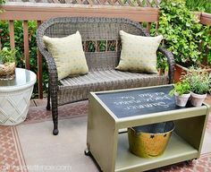 Old tv stand turned outdoor coffee table!