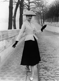 "1947 ""New Look"" Christian Dior.  In the 1940′s his opinion was that womens fashion was becoming too masculine and covered up.  Dior said he wanted to ""Bring back beauty, feminine clothing, soft rounded shapes and full flowing skirts"" like the women in the 1930′s.  In 1947, he debuted his new collection, most popularly known as ""the new look"".  The new look consisted of a rounded shoulders, cinched waist and bell skirts created in luxurious fabrics."