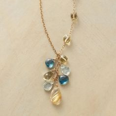 "LEMONDROP NECKLACE -- Lemon quartz cubes lead to a pale, pretty cluster on 14kt goldfilled links: London blue topaz, rutilated quartz and a lemon quartz drop. Lobster clasp. Handmade in USA for us. 24""L."