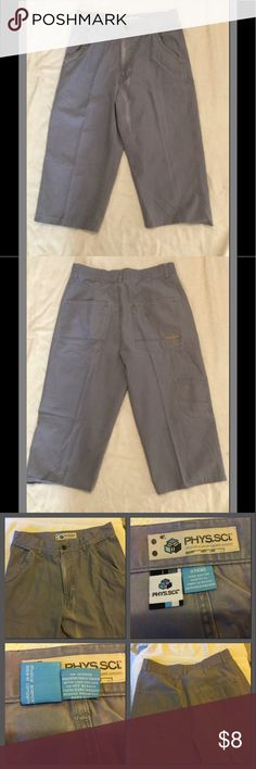 """Ever seen a tag """"Made in Russia""""? Me either. High waisted, cropped like board shorts, carpenter style, slate gray jeans. Measurements: waist 32"""" Rise 12"""" Inseam 26"""" total length 31  partial discoloration on front (sun bleached?), some of left hem has unglued, back darts. Super deep pockets. Phys. Sci Jeans Ankle & Cropped"""