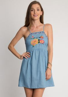 Blue denim mini dress with floral embroidered at chest, hidden back closure and adjustable shoulder straps. Unlined, opaque.  32