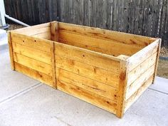 Raised planter on the cheap.  I might take on a woodworking project.