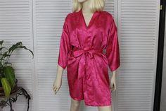 Vintage Short Hot Pink Silky Robe Kimono Style Size Medium 1980s by California Dynasty. $24.00, via Etsy.
