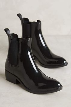 Jeffrey Campbell Stormy Chelsea Boots. Just bought these and they are so perfect! They don't even look like rubber boots and they look very similar to Saint Laurent patent boots I've been dreaming of!
