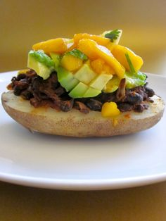 Black bean stuffed potato with mango salsa - this is the way to top a baked potato!