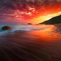 A beautiful sunset in Aphrodite's Rock, Paphos, Cyprus. Photo by tomasz.cc