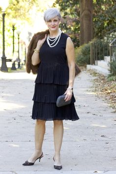 She also styled this with no necklace and then major dangling sparkly earrings.  little black dress
