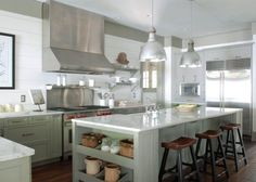 Gray-green cabinets, planked walls and fabulous pendants