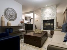 Income Property: Stone fireplace as focal point.