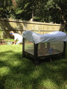Fitted sheet over playpen to keep bugs out and for shade AMAZING IDEA