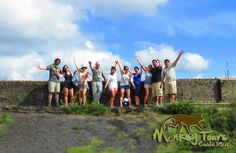 Guided tour group posing with their guide at the Masaya Volcano National Park in Nicaragua... See more at: https://www.costaricamonkeytours.com/costa-rica-tour-29/