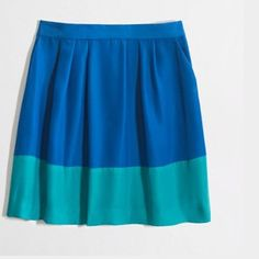 """J. Crew pleated colorblock skirt Paired with a button-down, it's office ready. Worn with a tee, it's weekend bound. (Either way, it's fluttery, feminine and perfect.) Poly. Sits at waist. Side zip. Slant pockets. Lined. 18"""" long. Dry clean.  From Factory J. Crew Skirts"""