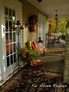 Adding rugs to your porch area help give it the feeling of being an extra room and not just somewhere you store your dirty shoes