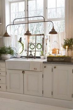 Wonderful lighting and farmhouse sink